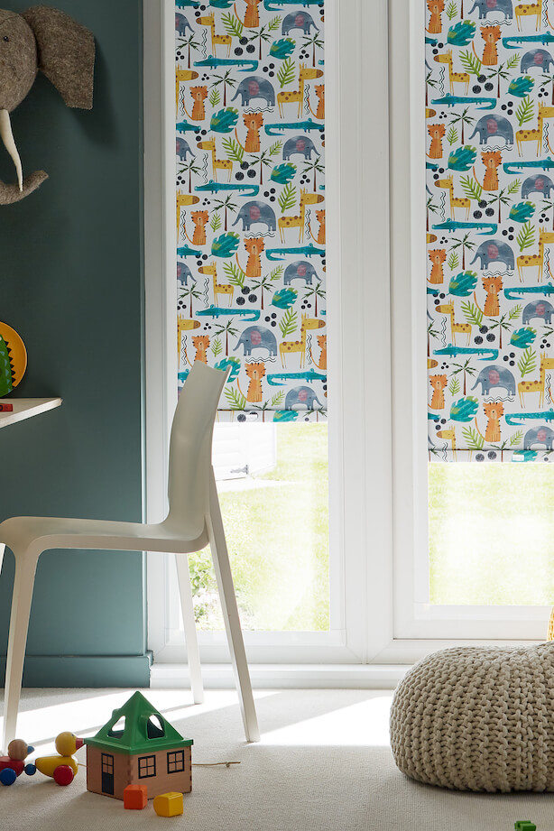 Tall thin windows in a child's play room, with Hillarys Perfect fit blinds on the window in Jungle Book Safari fabric print