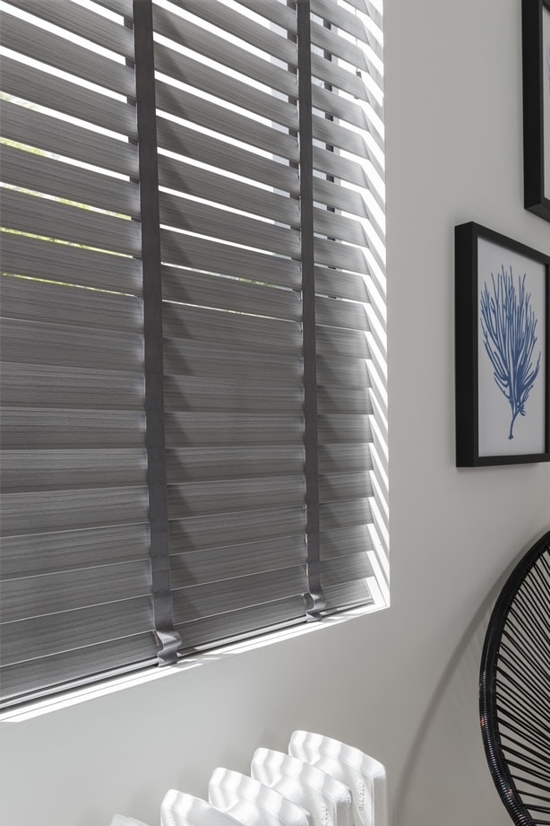 An office window fitted with a Hillarys faux Wooden blind in Lunaire Faux Wood style